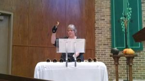 Joann playing bells